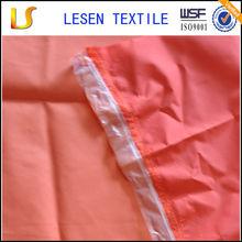 Shanghai Lesen textile waterproof nylon raincoat fabric,raincoat fabric
