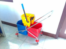 household cleaning trolley mop bucket with four wheels and steel handle