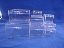 Small hinged clear plastic box used for packing