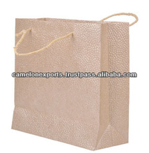 Indian manufactured wood free recycled cotton handmade paper eco friendly bag for gift/art/craft with metallic embossed design.