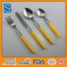 Yellow handle plastic table ware