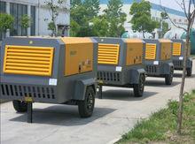 Portable air compressor for hammer rock drill