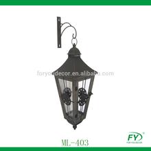 Hanging metal garden lantern with wood construction