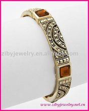 Antique Goldtone / Brown Acrylic Stone / Lead Compliant Metal / Marcasite Look / Stretch / Bracelet