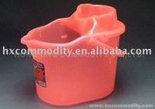 red plastic mop bucket with handle