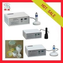 Manual induction heat sealer for bottles