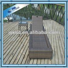 Table with Long rattan beach sun lounger