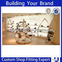 Tailor made modern design shiny metal shoe shine stand