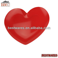 Red plastic heart shaped plate