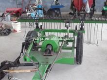 Tractor trailed grass cutting and rake machine