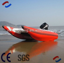 red rigid inflatable catamaran boat with outboard