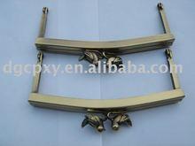 Antique metal bag frame with bird closure
