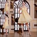 Une épaule courte longueur au genou en mousseline de soie paillettes or jaune robes de demoiselle d'honneur