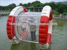 water park human hamster rolling water wheel