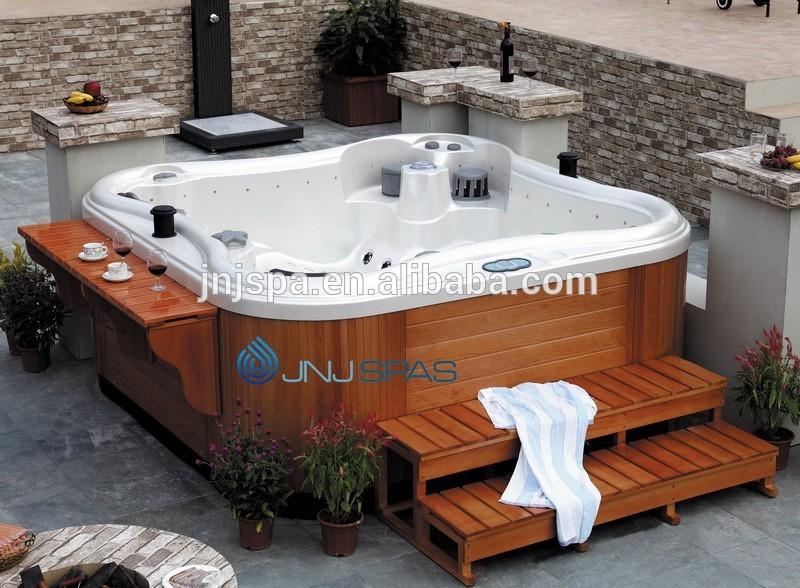 Jardin bain remous papillon spa ext rieur spabad spa for Bain a remous exterieur