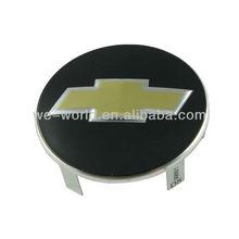 Car emblem and wheel badge