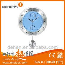 metal clock with pendulum