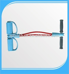 red abdominal exerciser with dipped latex tube