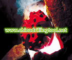 Tungsten carbide tipped well drill DTH bits