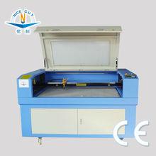 NC-C1490 Laser Engraving Machine engrave on round surfaces