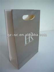 Shopping paper bag with die cutting handle with logo