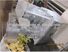 Apple peeling de-stoning and cutting-open machine