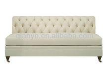 armless white leather sofa