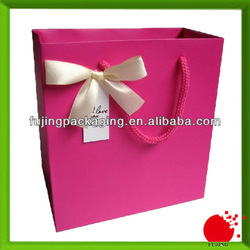 Fashionable pink gift packaging paper bag with ribbon tie
