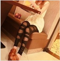 Free Shipping 2013 Bandaged hole gauze patchwork trousers cross straps fashion sexy leggings