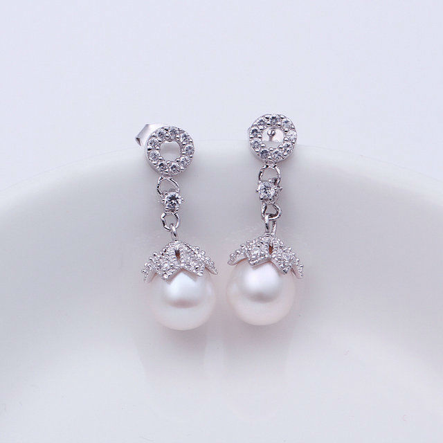 PLE013 outer surface is covered with silver inlaid Austrian crystal pearl earrings Wholesale free shipping(China (Mainland))