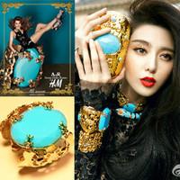 Free shipping Fashion hot-selling gold rehnestone elegant hand ring big gem blue bracelet