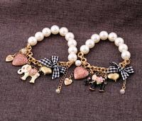 Free Shipping Fashion  Elastic bow pearl circleof women's bracelet Elephant Charm Bracelets Bangle