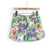Free shipping Pomeloes 2013 personalized fashion doodle color block decoration encoustic shorts flower pants female