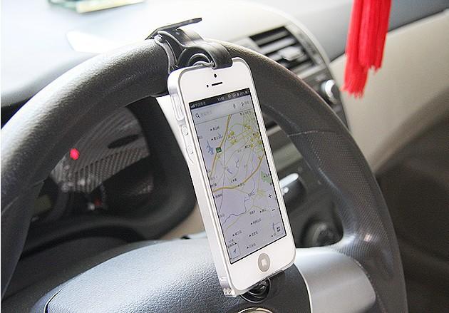http://i00.i.aliimg.com/wsphoto/v0/1080219032_2/Creative-car-phone-holder-Steering-wheel-stand-phone-support-navigation-frame-Retractable-Phone-Stent-free-shipping.jpg