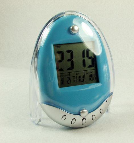 Fashion Beautiful Egg shape calendar alarm clock - with thermometer alarm music Wholesale retail AC07AK(China (Mainland))