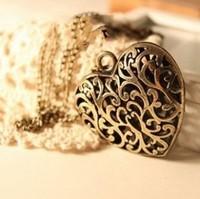 2014  A019 antique hollow heart carving Pendants necklaces for women