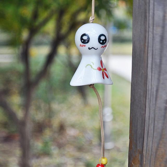 Cerâmica enforcamentos carro decoração de casa pequena pequeno vento boneca cabeça grande sinos presente de aniversário(China (Mainland))
