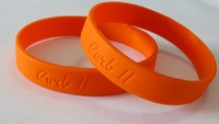 Debossed solid color silicone wristbands, 100pcs Lot, custom texts and logos