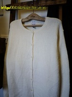 End of a single vintage preppy style pearl button o-neck sweater cardigan ivory