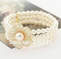 free shipping &  Three -rows  freshwater   peral  bracelet    with  a beautiful shell  flower