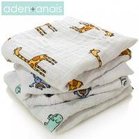 A single Aden anais newborn baby holds big newborn supplies blanket