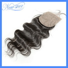 Brazilian Virgin Hair body wave Silk Base lace closure . 10-20inch in stock Free shipping(China (Mainland))
