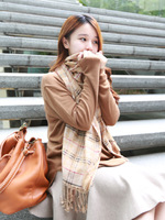Momonaco made khaki plaid scarf tassel .