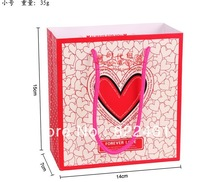 The new han edition of fashionable romance hollow heart-shaped pattern gift bag birthday gift paper bag  15*14*7CM