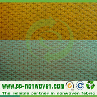 Cross design nonwoven fabric for bags