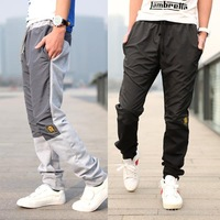 2013 HOT SALE MEN'S BOUTIQUE FASHION MEN'S EMBROIDERY PATCH RECREATIONAL SPORTS ELASTIC PANTS MF-42246