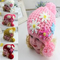 Free shipping lovely cotton baby boy girl flower hats and caps kids knitted beanie cap for children to keep warm cute craft