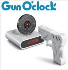 Sleep killer shooting fire alarm clock pistol shooting alarm clock is 600 grams(China (Mainland))