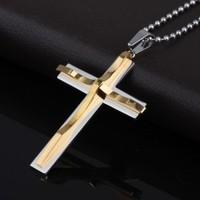 The appendtiff titanium gold cross pendant