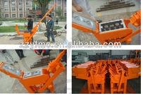 Hand operated clay interlocking brick making machine